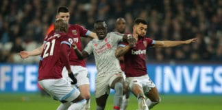 LONDON, ENGLAND - FEBRUARY 04: Sadio Mane of Liverpool battles for possession with Declan Rice, Angelo Ogbonna and Ryan Fredericks of West Ham United during the Premier League match between West Ham United and Liverpool FC at London Stadium on February 04, 2019 in London, United Kingdom. (Photo by Richard Heathcote/Getty Images)