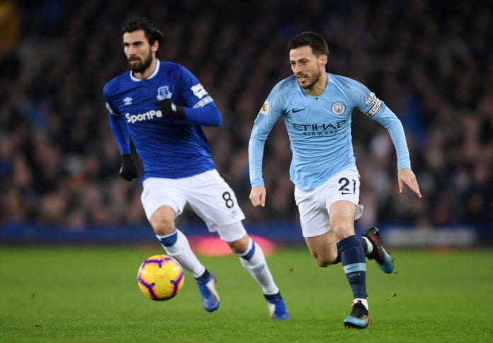 LIVERPOOL, ENGLAND - FEBRUARY 06: David Silva of Manchester City chases down Andre Gomes of Everton during the Premier League match between Everton FC and Manchester City at Goodison Park on February 06, 2019 in Liverpool, United Kingdom. (Photo by Laurence Griffiths/Getty Images)