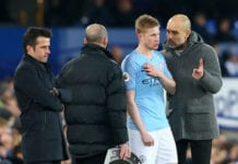 LIVERPOOL, ENGLAND - FEBRUARY 06: Josep Guardiola, Manager of Manchester City speaks with Kevin De Bruyne of Manchester City during the Premier League match between Everton FC and Manchester City at Goodison Park on February 06, 2019 in Liverpool, United Kingdom. (Photo by Alex Livesey/Getty Images)