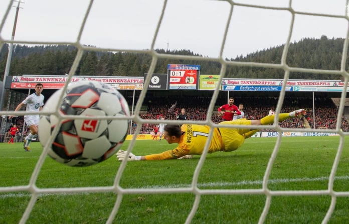 FREIBURG IM BREISGAU, GERMANY - FEBRUARY 09: Vincenzo Grifo of Freiburg scores his team's first goal during the Bundesliga match between Sport-Club Freiburg and VfL Wolfsburg at Schwarzwald-Stadion on February 09, 2019 in Freiburg im Breisgau, Germany. (Photo by Matthias Hangst/Bongarts/Getty Images)