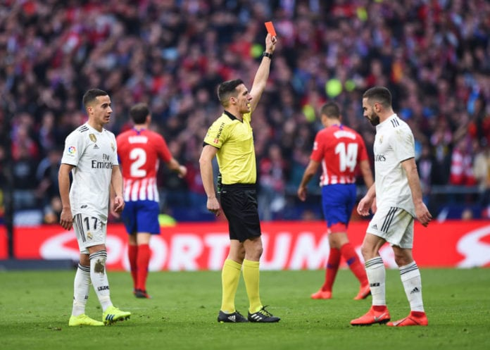 MADRID, SPAIN - FEBRUARY 09: Referee Estrada Fernandez shows a red card and sends off Thomas Partey of Atletico Madrid (not pictured) during the La Liga match between Club Atletico de Madrid and Real Madrid CF at Wanda Metropolitano on February 09, 2019 in Madrid, Spain. (Photo by Denis Doyle/Getty Images)