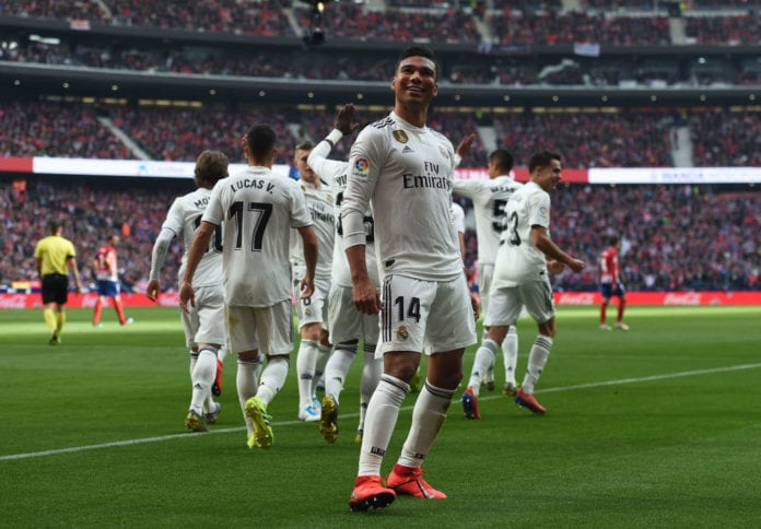 MADRID, SPAIN - FEBRUARY 09: Henrique Casemiro of Real Madrid celebrates after scoring Real's opening goal during the La Liga match between Club Atletico de Madrid and Real Madrid CF at Wanda Metropolitano on February 09, 2019 in Madrid, Spain. (Photo by Denis Doyle/Getty Images)