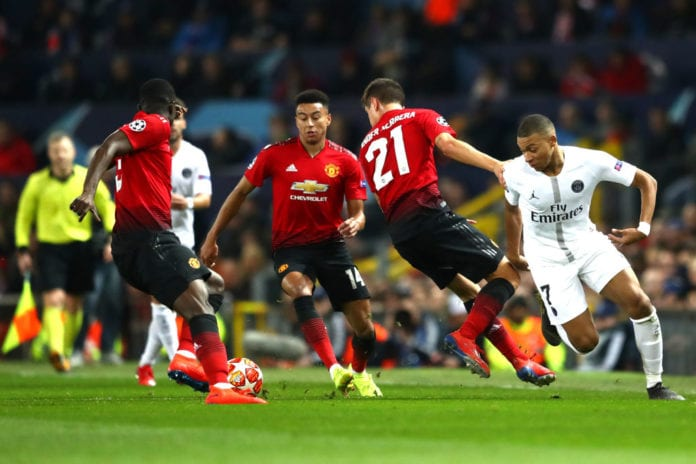MANCHESTER, ENGLAND - FEBRUARY 12: Kylian Mbappe of PSG is closed down by Ander Herrera and Jesse Lingard of Manchester United during the UEFA Champions League Round of 16 First Leg match between Manchester United and Paris Saint-Germain at Old Trafford on February 12, 2019 in Manchester, England. (Photo by Michael Steele/Getty Images)