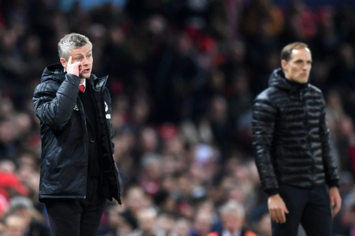 MANCHESTER, ENGLAND - FEBRUARY 12: Ole Gunnar Solskjaer, Manager of Manchester United and Thomas Tuchel, Manager of PSG stand on the touchline during the UEFA Champions League Round of 16 First Leg match between Manchester United and Paris Saint-Germain at Old Trafford on February 12, 2019 in Manchester, England. (Photo by Michael Regan/Getty Images)