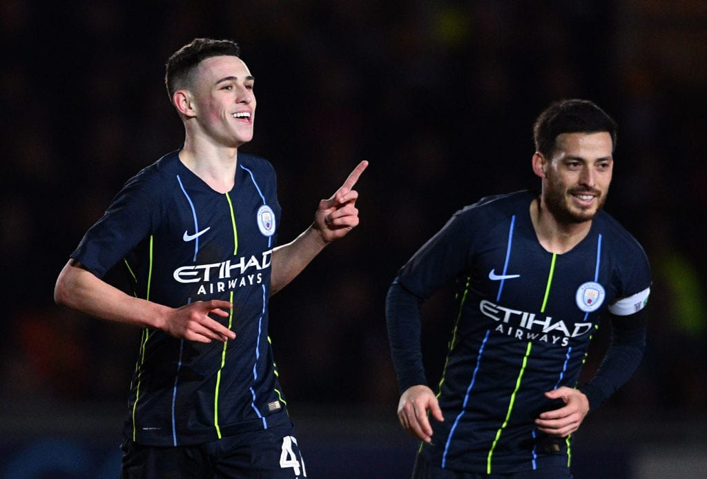 NEWPORT, WALES - FEBRUARY 16: Phil Foden of Manchester City(L) celebrates after scoring his sides third goal during the FA Cup Fifth Round match between Newport County AFC and Manchester City at Rodney Parade on February 16, 2019 in Newport, United Kingdom. (Photo by Harry Trump/Getty Images)