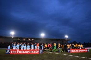 NEWPORT, WALES - FEBRUARY 16: The two teams make their way out for the start during the FA Cup Fifth Round match between Newport County AFC and Manchester City at Rodney Parade on February 16, 2019 in Newport, United Kingdom. (Photo by Harry Trump/Getty Images)