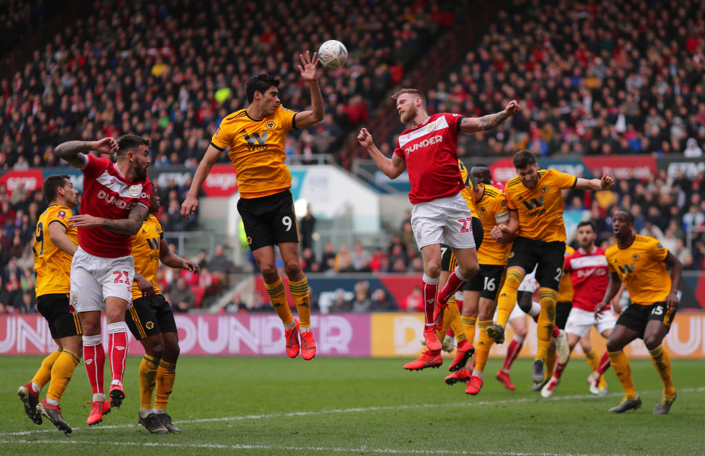 BRISTOL, ENGLAND - FEBRUARY 17: Raul Jimenez of Wolverhampton Wanderers (9) and Tomas Kalas of Bristol City (22) challenge for a header during the FA Cup Fifth Round match between Bristol City and Wolverhampton Wanderers at Ashton Gate on February 17, 2019 in Bristol, United Kingdom. (Photo by Richard Heathcote/Getty Images)