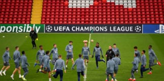 LIVERPOOL, ENGLAND - FEBRUARY 18: The Bayern Munich team take part in some stretches during the FC Bayern Muenchen Training Session ahead of the UEFA Champions League Round of 16 First Leg match between Liverpool and FC Bayern Muenchen at Anfield on February 18, 2019 in Liverpool, England. (Photo by Clive Brunskill/Getty Images)