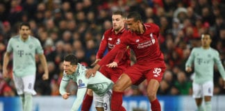 LIVERPOOL, ENGLAND - FEBRUARY 19: Robert Lewandowski of Bayern Munich tangles with Joel Matip and Jordan Henderson of Liverpool during the UEFA Champions League Round of 16 First Leg match between Liverpool and FC Bayern Muenchen at Anfield on February 19, 2019 in Liverpool, England. (Photo by Stu Forster/Getty Images)