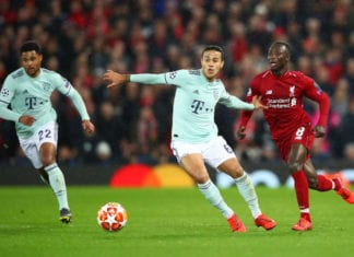 LIVERPOOL, ENGLAND - FEBRUARY 19: Thiago Alcantara of Bayern Munich holds off Naby Keita of Liverpool during the UEFA Champions League Round of 16 First Leg match between Liverpool and FC Bayern Muenchen at Anfield on February 19, 2019 in Liverpool, England. (Photo by Clive Brunskill/Getty Images)
