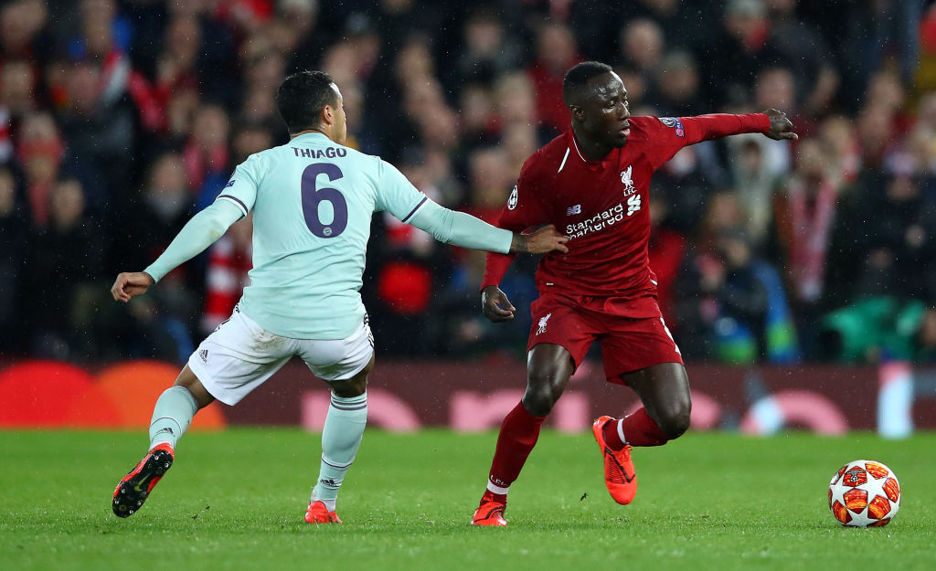 LIVERPOOL, ENGLAND - FEBRUARY 19: Naby Keita of Liverpool attempts to move away from Thiago Alcantara of Bayern Munchen during the UEFA Champions League Round of 16 First Leg match between Liverpool and FC Bayern Muenchen at Anfield on February 19, 2019 in Liverpool, England. (Photo by Clive Brunskill/Getty Images)