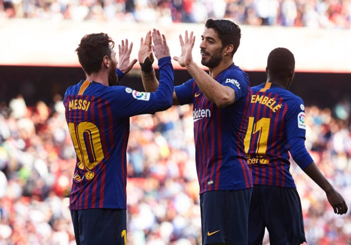 SEVILLE, SPAIN - FEBRUARY 23:Luis Suarez of FC Barcelona celebrates with his teammates Lionel Messi of FC Barcelona after scoring his team's fourth goal during the La Liga match between Sevilla FC and FC Barcelona at Estadio Ramon Sanchez Pizjuan on February 23, 2019 in Seville, Spain. (Photo by Aitor Alcalde/Getty Images)