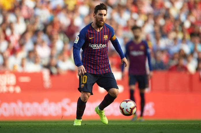 SEVILLE, SPAIN - FEBRUARY 23: Lionel Messi of FC Barcelona runs with the ball during the La Liga match between Sevilla FC and FC Barcelona at Estadio Ramon Sanchez Pizjuan on February 23, 2019 in Seville, Spain. (Photo by Aitor Alcalde/Getty Images)