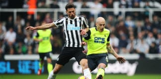 NEWCASTLE UPON TYNE, ENGLAND - FEBRUARY 23: Fabian Schar of Newcastle United vies with Aaron Mooy of Huddersfield Town during the Premier League match between Newcastle United and Huddersfield Town at St. James Park on February 23, 2019 in Newcastle upon Tyne, United Kingdom. (Photo by Ian MacNicol/Getty Images)