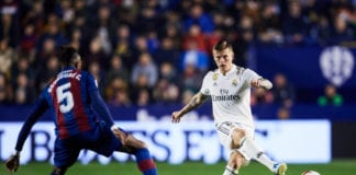 VALENCIA, SPAIN - FEBRUARY 24: Toni Kroos of Real Madrid CF plays the ball next to Cheick Ives Doukoure of Levante UD during the La Liga match between Levante UD and Real Madrid CF at Ciutat de Valencia on February 24, 2019 in Valencia, Spain. (Photo by Alex Caparros/Getty Images)