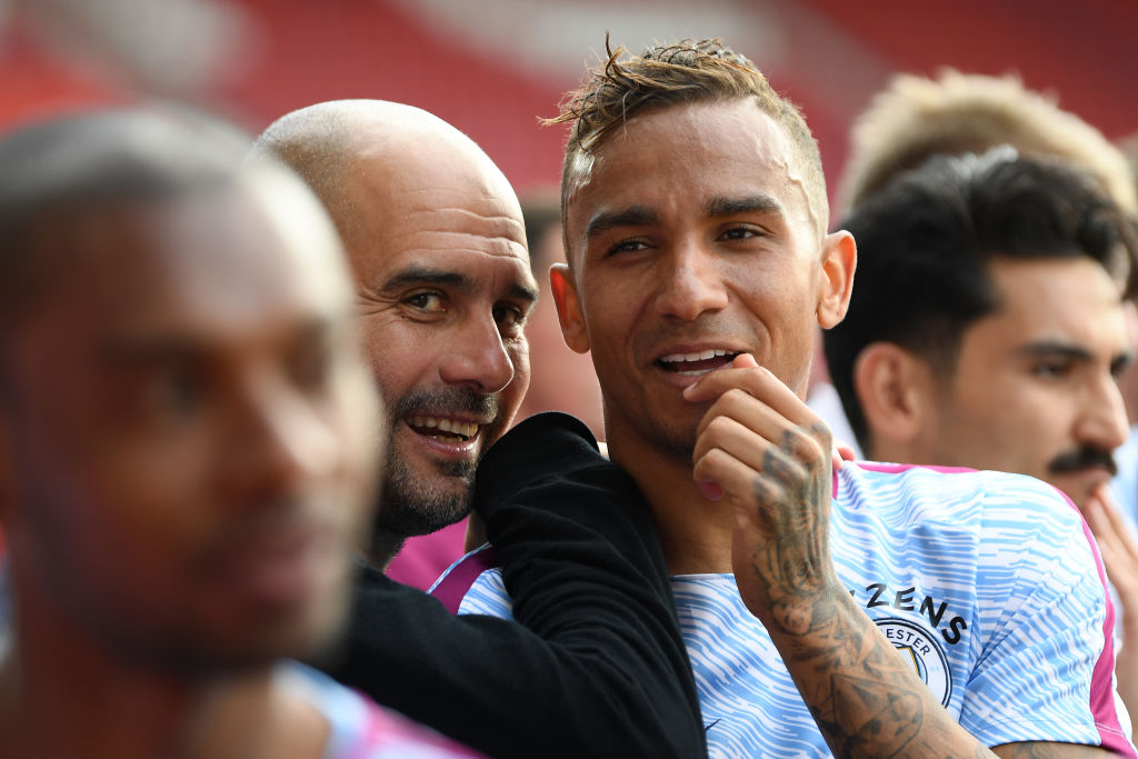 SOUTHAMPTON, ENGLAND - MAY 13: Manchester City manager Pep Guardiola shares a moment with Danilo of Manchester City during the Premier League match between Southampton and Manchester City at St Mary's Stadium on May 13, 2018 in Southampton, England. (Photo by Mike Hewitt/Getty Images)