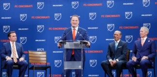 CINCINNATI, OH - MAY 29: FC Cincinnati president and general manager Jeff Berding speaks as principal owner Carl Lindner III, MLS commissioner Don Garber and Cincinnati mayor John Cranley look on during an announcement awarding FC Cincinnati an expansion franchise on May 29, 2018 in Cincinnati, Ohio. (Photo by Joe Robbins/Getty Images)