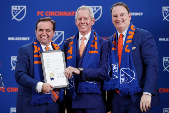 CINCINNATI, OH - MAY 29: FC Cincinnati president and general manager Jeff Berding and principal owner Carl Lindner III (from right) look on as Cincinnati mayor John Cranley proclaims 'Orange and Blue Day' after the team was awarded an MLS expansion franchise on May 29, 2018 in Cincinnati, Ohio. (Photo by Joe Robbins/Getty Images)