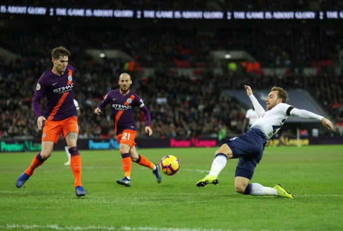 LONDON, ENGLAND - OCTOBER 29: Christian Eriksen of Tottenham Hotspur shoots during the Premier League match between Tottenham Hotspur and Manchester City at Wembley Stadium on October 29, 2018 in London, United Kingdom. (Photo by Richard Heathcote/Getty Images)