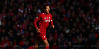 LIVERPOOL, ENGLAND - NOVEMBER 11: Virgil van Dijk of Liverpool runs with the ball during the Premier League match between Liverpool FC and Fulham FC at Anfield on November 11, 2018 in Liverpool, United Kingdom. (Photo by Alex Livesey/Getty Images)