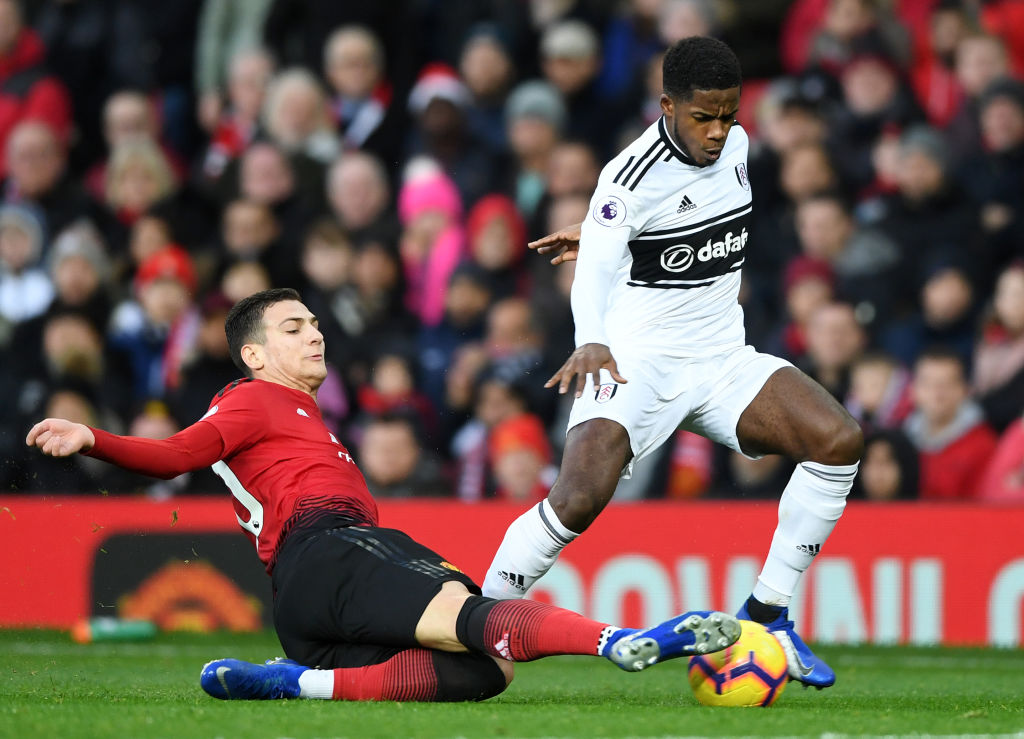MANCHESTER, ENGLAND - DECEMBER 08: Diogo Dalot of Manchester United is challenged by Ryan Sessegnon of Fulham during the Premier League match between Manchester United and Fulham FC at Old Trafford on December 8, 2018 in Manchester, United Kingdom. (Photo by Gareth Copley/Getty Images)