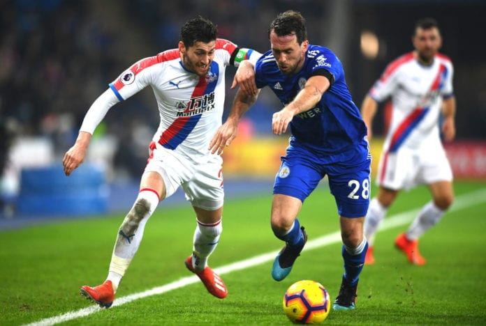 LEICESTER, ENGLAND - FEBRUARY 23: Christian Fuchs of Leicester City battles for possession with Joel Ward of Crystal Palace during the Premier League match between Leicester City and Crystal Palace at The King Power Stadium on February 23, 2019 in Leicester, United Kingdom. (Photo by Clive Mason/Getty Images)