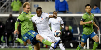SEATTLE, WA - MARCH 02: Fanendo Adi #9 of FC Cincinnati battles for a ball with Chad Marshall #14 of the Seattle Sounders during the second half of the match at CenturyLink Field on March 2, 2019 in Seattle, Washington. The sounders won 4-1. (Photo by Steve Dykes/Getty Images)
