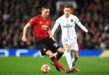 MANCHESTER, ENGLAND - FEBRUARY 12: Nemanja Matic of Manchester United is tackled by Julian Draxler of PSG during the UEFA Champions League Round of 16 First Leg match between Manchester United and Paris Saint-Germain at Old Trafford on February 12, 2019 in Manchester, England. (Photo by Michael Regan/Getty Images)