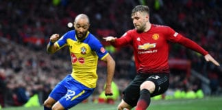 MANCHESTER, ENGLAND - MARCH 02: Nathan Redmond of Soutampton is challenged by Luke Shaw of Manchester United during the Premier League match between Manchester United and Southampton FC at Old Trafford on March 02, 2019 in Manchester, United Kingdom. (Photo by Clive Mason/Getty Images)