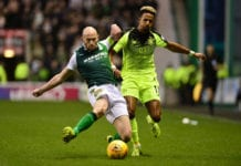 EDINBURGH, SCOTLAND - MARCH 02: Scott Sinclair of Celtic is challenged by David Gray of Hibernian during the Scottish Cup quarter final match between Hibernian and Celtic at Easter Road on March 02, 2019 in Edinburgh, Scotland. (Photo by Mark Runnacles/Getty Images)