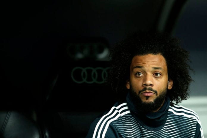 MADRID, SPAIN - MARCH 02: Marcelo of Real Madrid looks on from the bench during the La Liga match between Real Madrid CF and FC Barcelona at Estadio Santiago Bernabeu on March 02, 2019 in Madrid, Spain. (Photo by Gonzalo Arroyo Moreno/Getty Images)