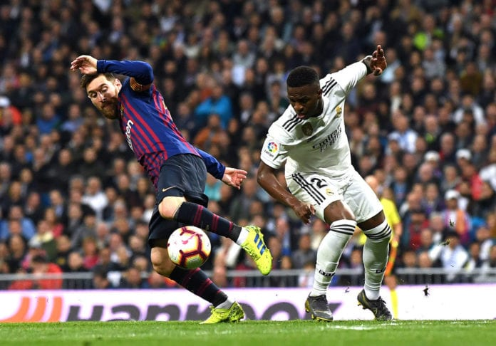 MADRID, SPAIN - MARCH 02: Lionel Messi of Barcelona and Vinicius Junior of Real Madrid in action during the La Liga match between Real Madrid CF and FC Barcelona at Estadio Santiago Bernabeu on March 02, 2019 in Madrid, Spain. (Photo by David Ramos/Getty Images)