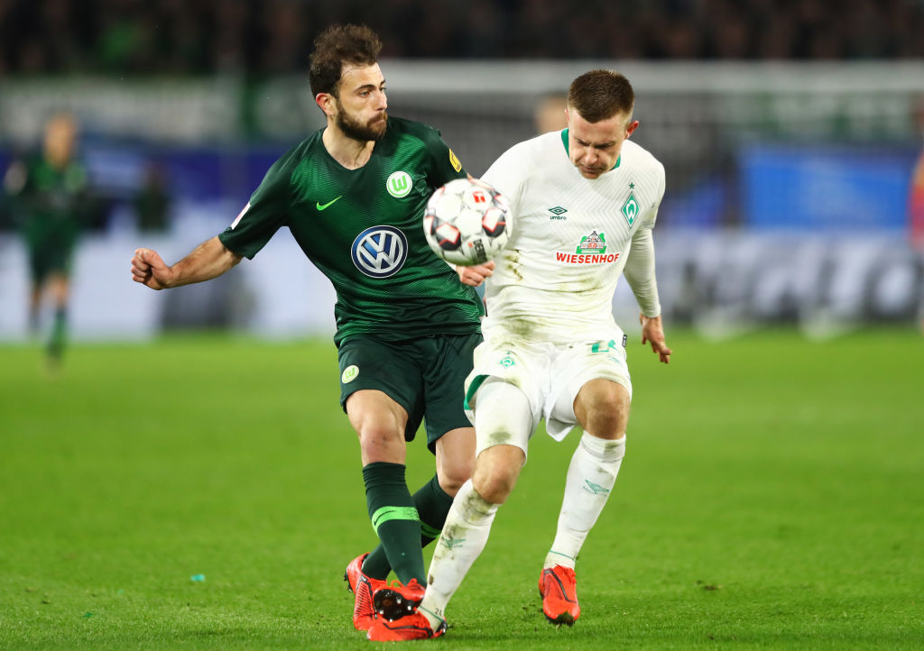 WOLFSBURG, GERMANY - MARCH 03: Admir Mehmedi of VfL Wolfsburg and Johannes Eggestein of Werder Bremen battle for the ball during the Bundesliga match between VfL Wolfsburg and SV Werder Bremen at Volkswagen Arena on March 03, 2019 in Wolfsburg, Germany. (Photo by Martin Rose/Bongarts/Getty Images)