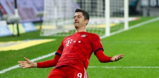 MOENCHENGLADBACH, GERMANY - MARCH 02: Robert Lewandowski #9 of Bayern Munich celebrates after scoring his team's third goal during the Bundesliga match between Borussia Moenchengladbach and FC Bayern Muenchen at Borussia-Park on March 02, 2019 in Moenchengladbach, Germany. (Photo by Maja Hitij/Bongarts/Getty Images)