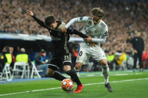 MADRID, SPAIN - MARCH 05: Nicolas Tagliafico of Ajax battles with Luka Modric of Real Madrid during the UEFA Champions League Round of 16 Second Leg match between Real Madrid and Ajax at Bernabeu on March 05, 2019 in Madrid, Spain. (Photo by David Ramos/Getty Images)