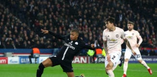 PARIS, FRANCE - MARCH 06: Kylian Mbappe of PSG stretches for the ball during the UEFA Champions League Round of 16 Second Leg match between Paris Saint-Germain and Manchester United at Parc des Princes on March 06, 2019 in Paris, . (Photo by Julian Finney/Getty Images)