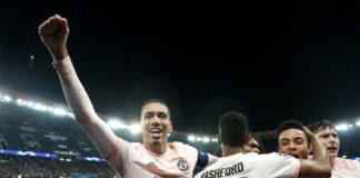 PARIS, FRANCE - MARCH 06: Chris Smalling celebrates his sides third goal scores by Marcus Rashford of Manchester United (Not pictured) during the UEFA Champions League Round of 16 Second Leg match between Paris Saint-Germain and Manchester United at Parc des Princes on March 06, 2019 in Paris, . (Photo by Julian Finney/Getty Images)