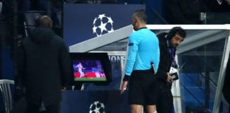 PARIS, FRANCE - MARCH 06: The match referee checks the VAR system before awarding a penalty in favor of Manchester United during the UEFA Champions League Round of 16 Second Leg match between Paris Saint-Germain and Manchester United at Parc des Princes on March 06, 2019 in Paris, . (Photo by Julian Finney/Getty Images)