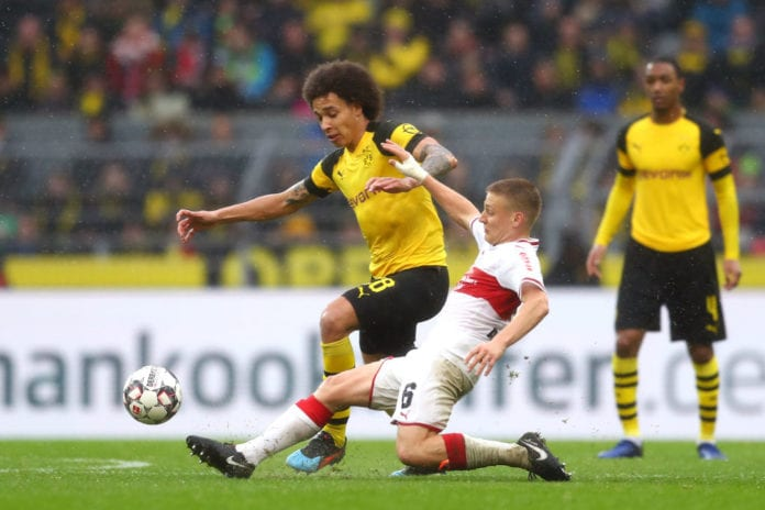 DORTMUND, GERMANY - MARCH 09: Axel Witsel of Borussia Dortmund is challenged by Santiago Ascacibar of VfB Stuttgart during the Bundesliga match between Borussia Dortmund and VfB Stuttgart at Signal Iduna Park on March 09, 2019 in Dortmund, Germany. (Photo by Lars Baron/Bongarts/Getty Images)