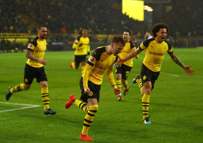 DORTMUND, GERMANY - MARCH 09: Marco Reus of Borussia Dortmund celebrates after scoring his team's first goal from the penalty spot during the Bundesliga match between Borussia Dortmund and VfB Stuttgart at Signal Iduna Park on March 09, 2019 in Dortmund, Germany. (Photo by Lars Baron/Bongarts/Getty Images)