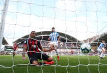 HUDDERSFIELD, ENGLAND - MARCH 09: Callum Wilson of AFC Bournemouth scores his team's first goal during the Premier League match between Huddersfield Town and AFC Bournemouth at John Smith's Stadium on March 09, 2019 in Huddersfield, United Kingdom. (Photo by Matthew Lewis/Getty Images)