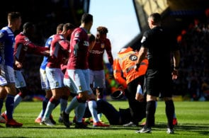 BIRMINGHAM, ENGLAND - MARCH 10: A pitch invader is tackled by a steward after striking Jack Grealish of Aston Villa during the Sky Bet Championship match between Birmingham City and Aston Villa at St Andrew's Trillion Trophy Stadium on March 10, 2019 in Birmingham, England. (Photo by Alex Davidson/Getty Images)