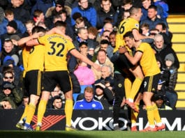LONDON, ENGLAND - MARCH 10: Raul Jimenez of Wolverhampton Wanderers celebrates with teammates after scoring his team's first goal during the Premier League match between Chelsea FC and Wolverhampton Wanderers at Stamford Bridge on March 10, 2019 in London, United Kingdom. (Photo by Mike Hewitt/Getty Images)