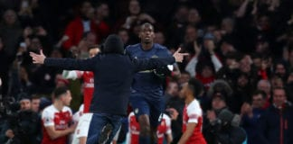 LONDON, ENGLAND - MARCH 10: A pitch invader runs towards Paul Pogba of Manchester United as he goes to join the celebration with Pierre-Emerick Aubameyang of Arsenal during the Premier League match between Arsenal FC and Manchester United at Emirates Stadium on March 10, 2019 in London, United Kingdom. (Photo by Catherine Ivill/Getty Images)