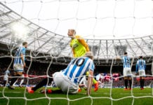 LONDON, ENGLAND - MARCH 16: Jonas Lossl of Huddersfield Town and Aaron Mooy of Huddersfield Town react after West Ham United scored there second goal of the goal during the Premier League match between West Ham United and Huddersfield Town at London Stadium on March 16, 2019 in London, United Kingdom. (Photo by Christopher Lee/Getty Images)