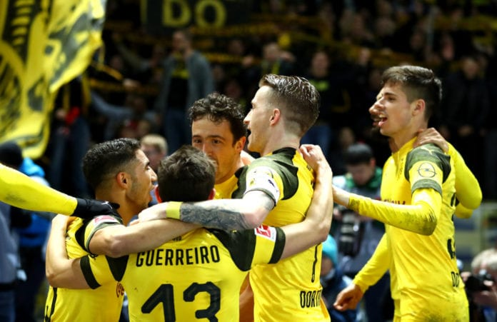 BERLIN, GERMANY - MARCH 16: Marco Reus of Borussia Dortmund celebrates victory with teammates following the Bundesliga match between Hertha BSC and Borussia Dortmund at Olympiastadion on March 16, 2019 in Berlin, Germany. (Photo by Martin Rose/Bongarts/Getty Images)