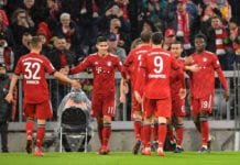 MUNICH, GERMANY - MARCH 17: Alphonso Davies (r) of Bayern Munich celebrates scoring his teams sixth goal with teammates during the Bundesliga match between FC Bayern Muenchen and 1. FSV Mainz 05 at Allianz Arena on March 17, 2019 in Munich, Germany. (Photo by Sebastian Widmann/Bongarts/Getty Images)