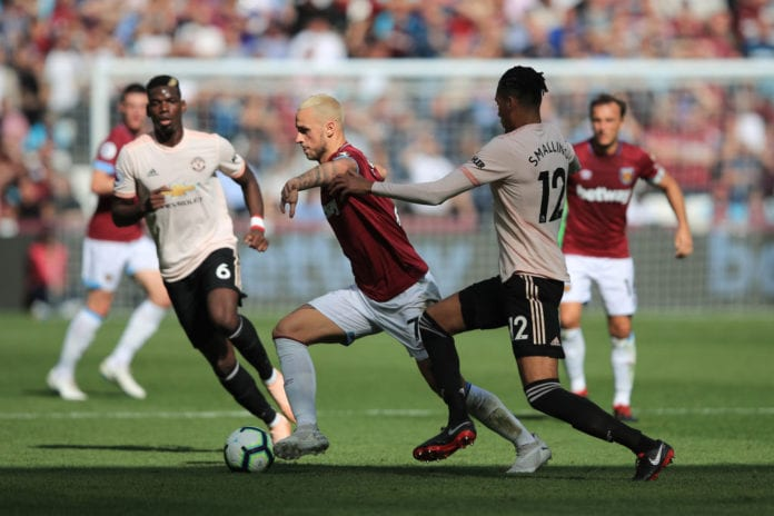 LONDON, ENGLAND - SEPTEMBER 29: Marko Arnautovic of West Ham United in action with Paul Pogba and Chris Smalling of Manchester United during the Premier League match between West Ham United and Manchester United at London Stadium on September 29, 2018 in London, United Kingdom. (Photo by Marc Atkins/Getty Images)