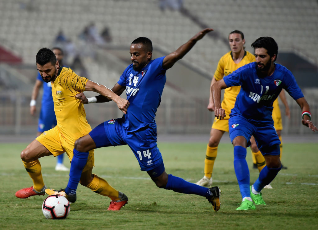 KUWAIT CITY, KUWAIT - OCTOBER 15: Aziz Behich of Australia and Dhari Sa'ed of Kuwait battle for the ball during the International Friendly match between Kuwait and Australia at Al Kuwait Sports Club Stadium on October 15, 2018 in Kuwait City, Kuwait. (Photo by Tom Dulat/Getty Images)