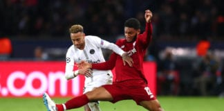 PARIS, FRANCE - NOVEMBER 28: Neymar of Paris Saint-Germain is challenged by Joe Gomez of Liverpool during the UEFA Champions League Group C match between Paris Saint-Germain and Liverpool at Parc des Princes on November 28, 2018 in Paris, France. (Photo by Clive Rose/Getty Images)